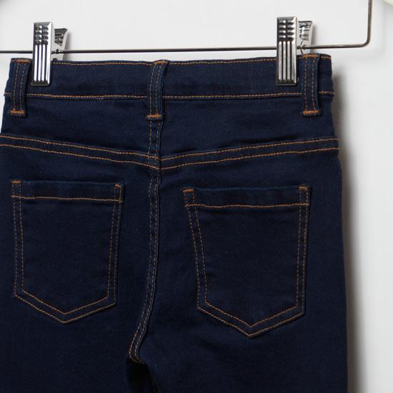 بنطلون جينز بجيوب وحلقات حزام وتفاصيل يونيكورن بالترتر
