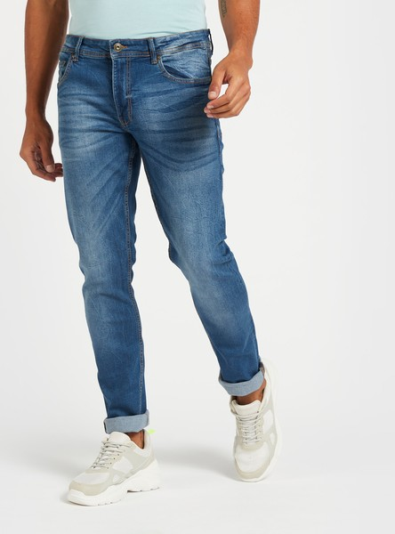 بنطلون جينز سادة سكيني بخصر متوسّط الإرتفاع وجيوب