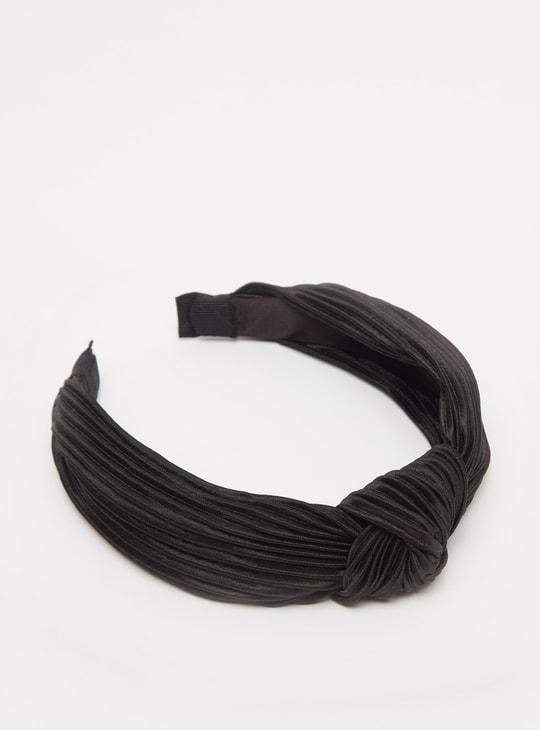 ربطة شعر عريضة بارزة الملمس بعقدة أمامية