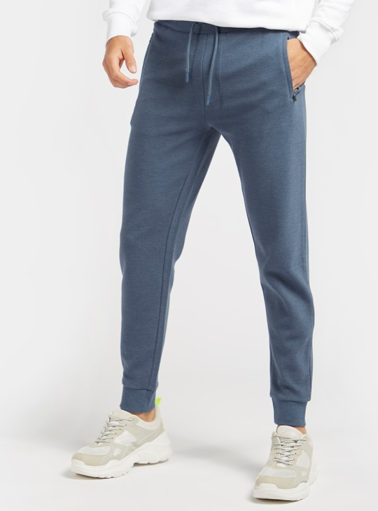 Slim Fit Ottoman Mid-Rise Jog Pants with Zip Pockets and Drawstring Closure