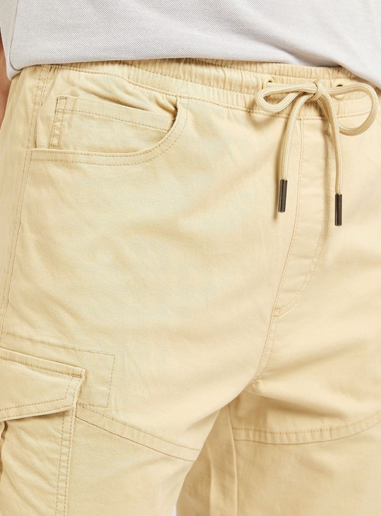 Solid Mid-Rise Ankle Length Cargo Joggers with Drawstring Closure