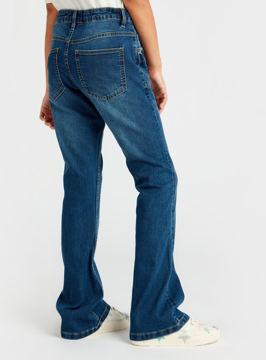 بنطلون جينز طويل واسع بزر إغلاق وجيوب