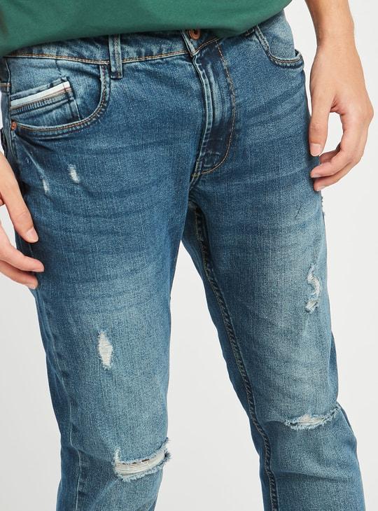 بنطلون جينز سليم ممزق بتفاصيل جيوب وعراوي