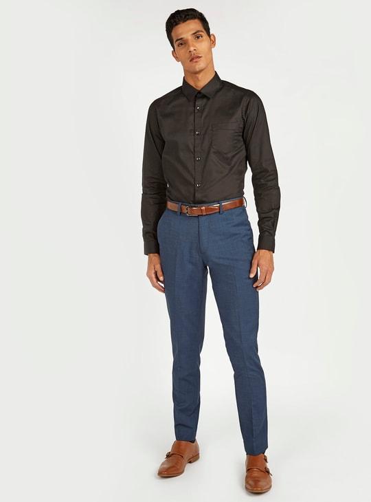 قميص دون أكمام سادة بتفاصيل جيوب ووصلة أزرار كاملة