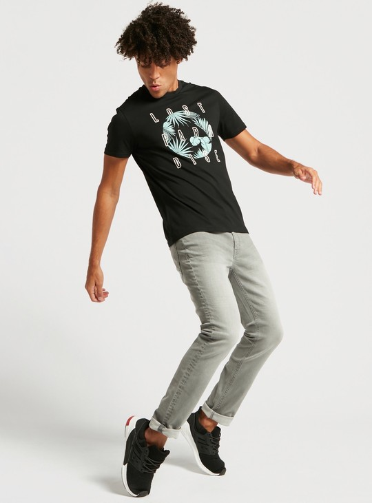 Slim Fit Solid Mid-Rise Jeans with Pocket Detail and Belt Loops