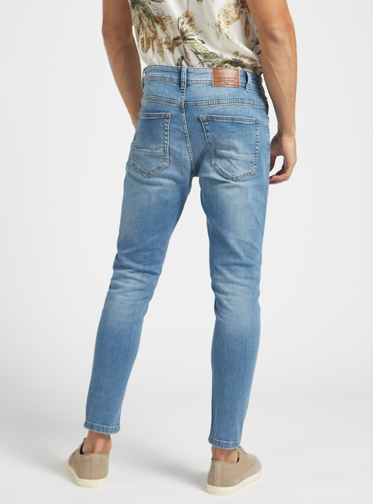 Carrot Fit Solid Mid-Rise Jeans with Pocket Detail and Belt Loops