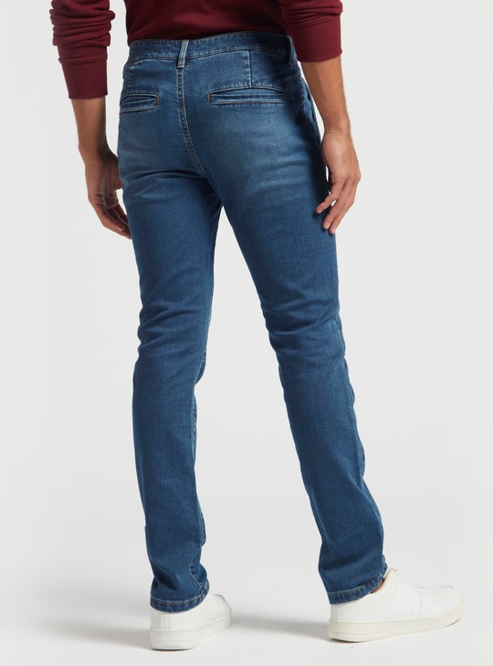 بنطلون جينز سليم سادة بحلقات حزام وتفاصيل جيوب