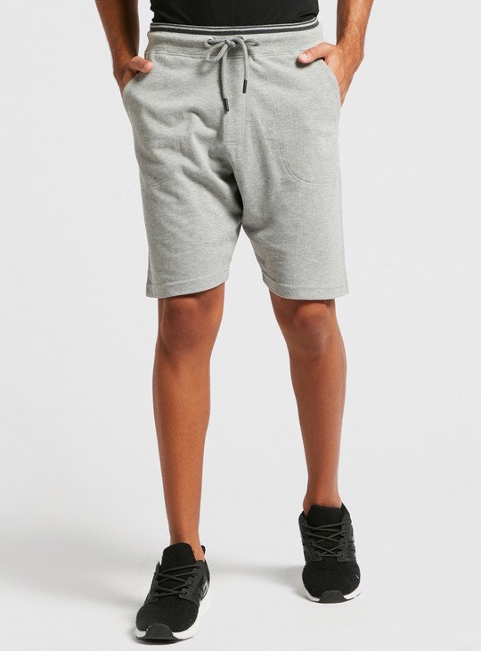 Solid Pique Knit Mid-Rise Shorts with Tipped Rib and Pocket Detail