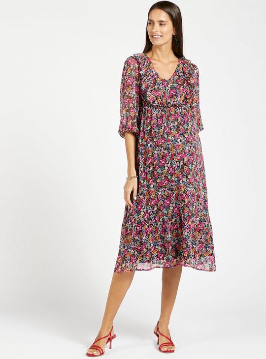 فستان ميدي إيه لاين بياقة V وأكمام 3/4 وطبعات زهرية