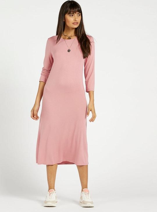 فستان ميدي واسع سادة بأكمام 3/4 وياقة مستديرة