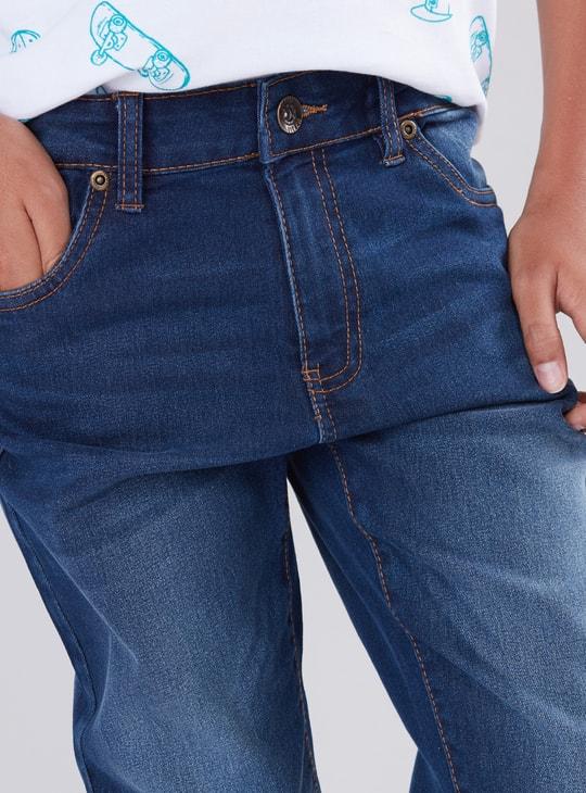 بنطال جينز طويل بزر وجيوب
