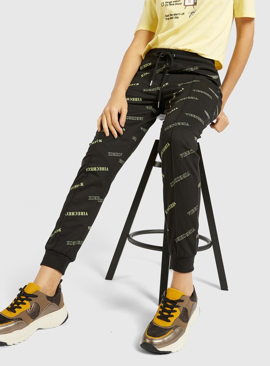 Full Length All-Over Text Print Jog Pants with Drawstring Closure