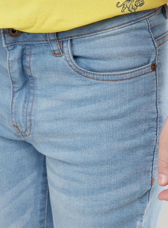 بنطلون جينز بحواف مثنية لأعلى وجيوب