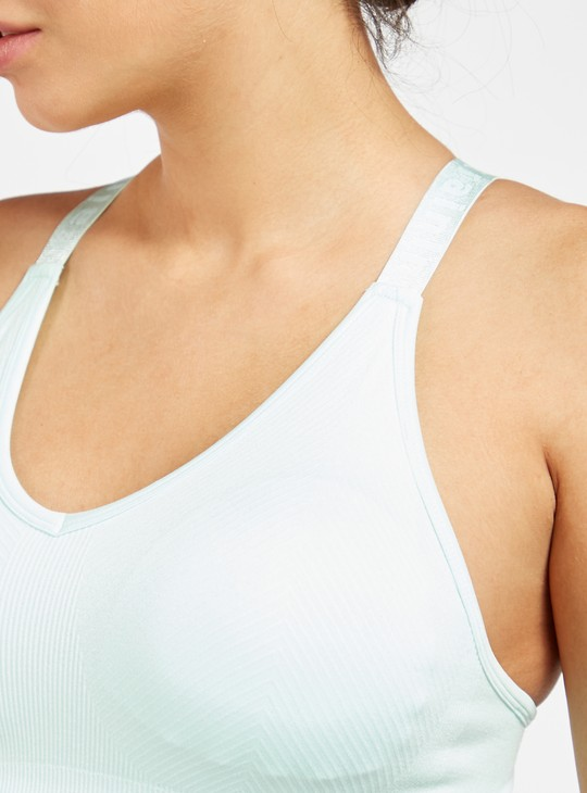 صدرية رياضية بارزة الملمس دعم متوسط متداخلة بأحزمة متقاطعة