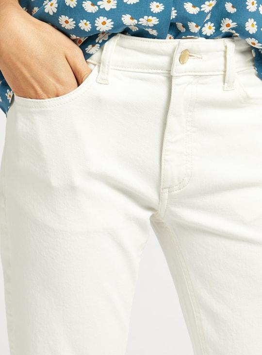 بنطلون جينز سادة يلائم الأحذية الطويلة بخصر متوسط الارتفاع وجيوب وسحاب للإغلاق
