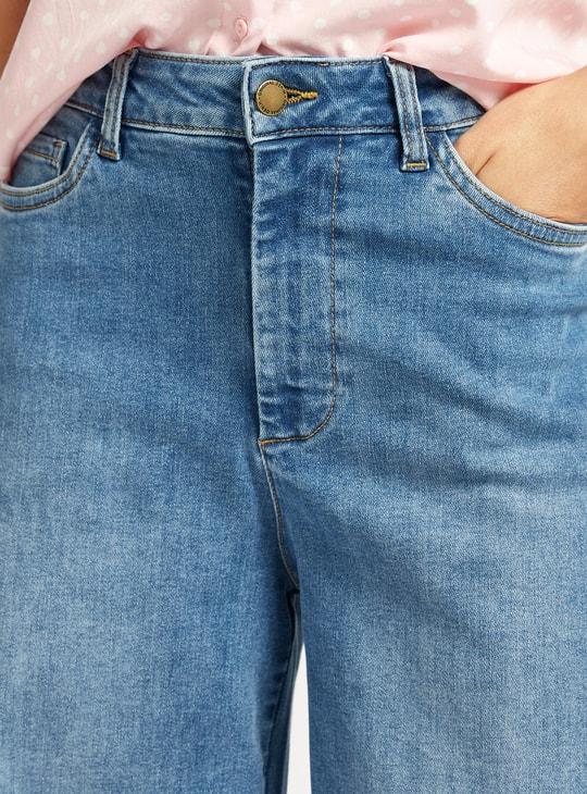بنطلون جينز سادة يلائم الأحذية الطويلة بخصر مرتفع وجيوب وسحاب للإغلاق
