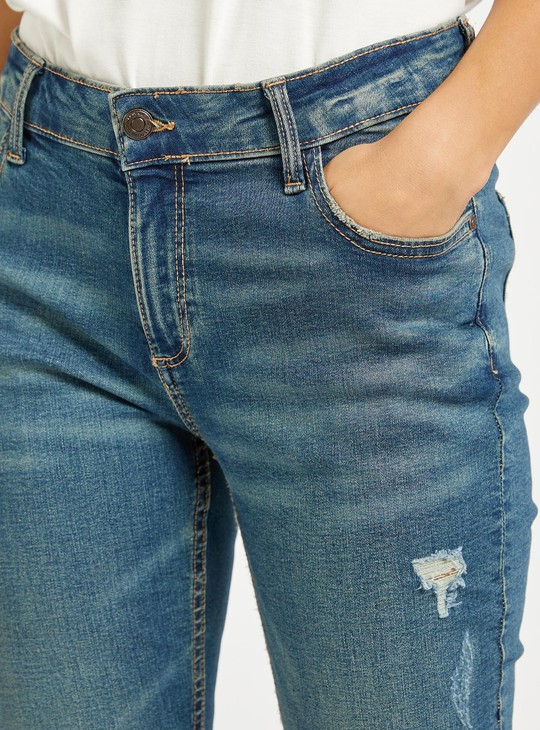 بنطلون جينز مضلّع سكيني بطول الكاحل وبزر إغلاق