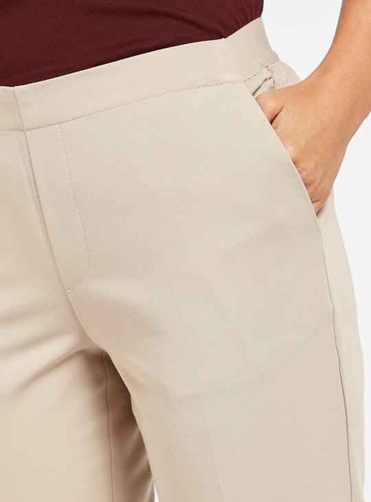 بنطلون سادة متوسط الارتفاع بتفاصيل جيوب
