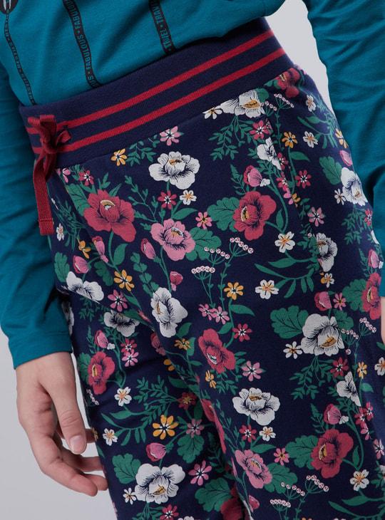 بنطلون رياضي طويل بطبعات أزهار وتفاصيل جيوب ورباط