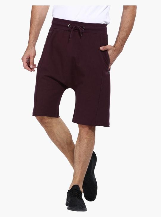 Drop Crotch Shorts in Slim Fit with Raw Hem