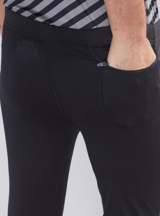 سروال جري بطول 3/4 وخصر مطاطي وطبعات