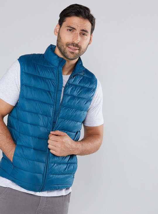 Quilted Sleeveless Jacket with Pocket Detail and Zip Closure