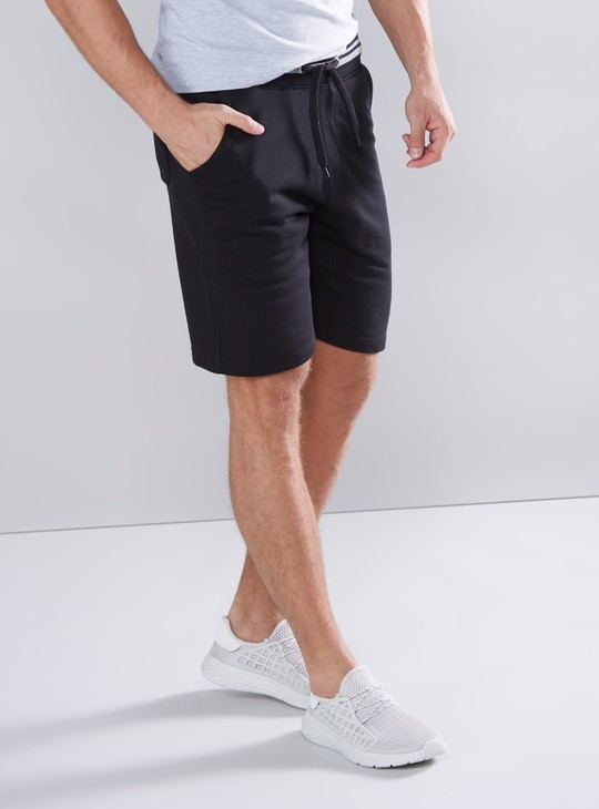 Solid Mid-Rise Shorts with Drawstring Closure and Striped Waistband