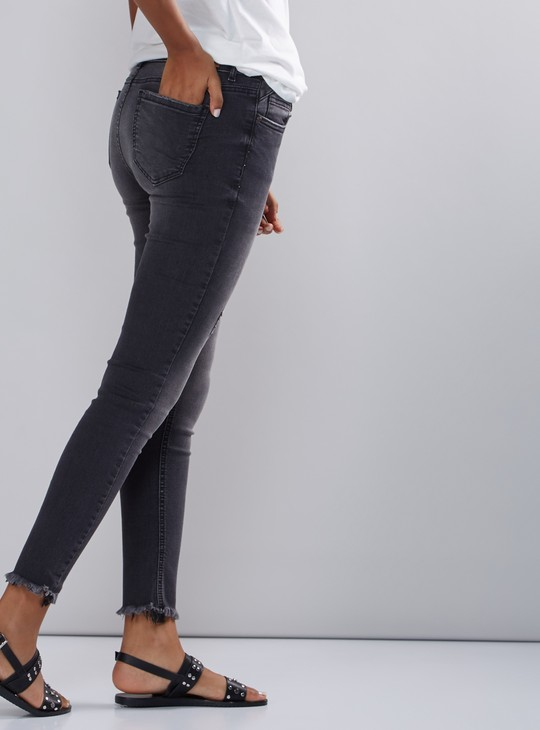 Distressed Jeans with Button Closure and Frayed Grazers