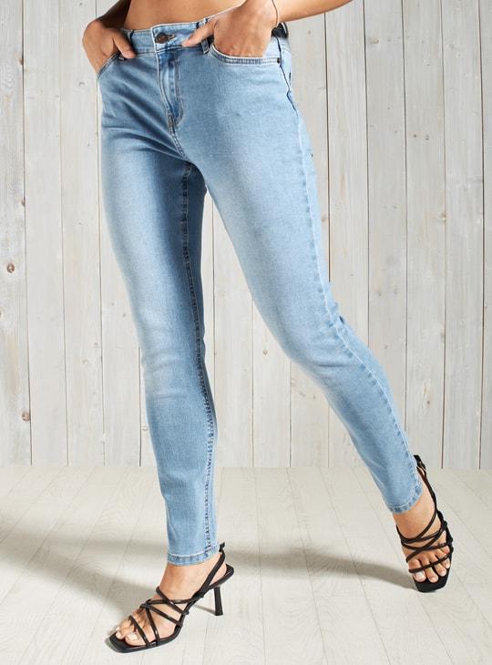 بنطلون جينز سكيني بخصر متوسط الارتفاع وزر إغلاق وجيوب