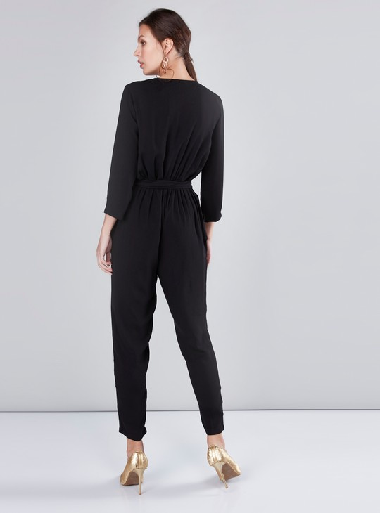 Pocket Detail Jumpsuit with 3/4 Sleeves and Tie Ups