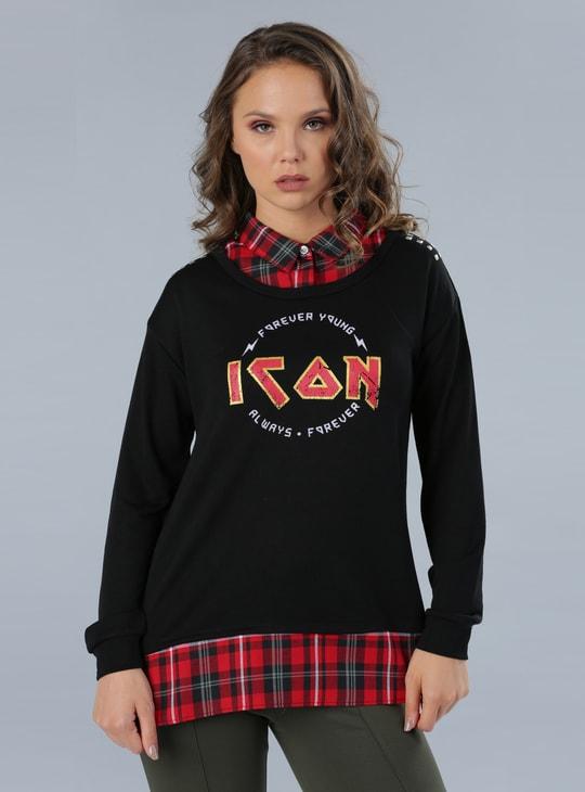 بلوزة منقوشة بأكمام طويلة وتصميم يشبه القميص