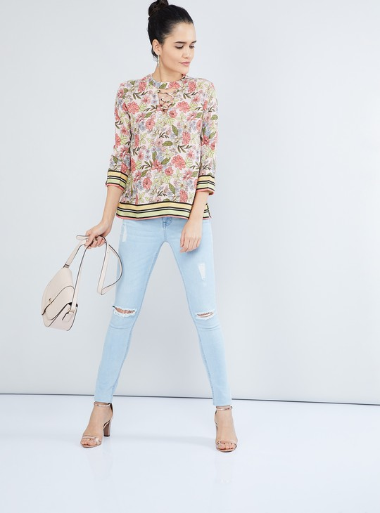 MAX Printed Three-Quarter Sleeve Criss-Cross Cut-Out Detailed Top