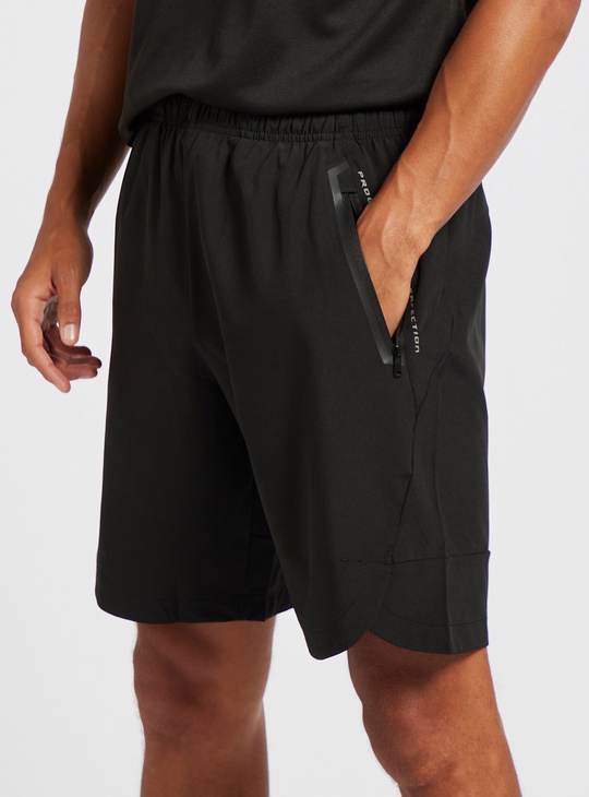 Solid Knee Length Shorts with Elasticised Waistband and Zipped Pockets