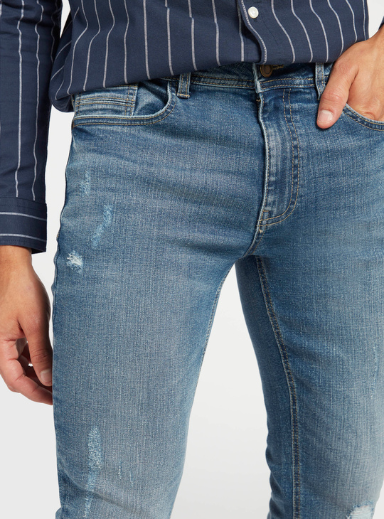 Mid-Rise Ripped Denim Jeans with Pockets and Zip Closure