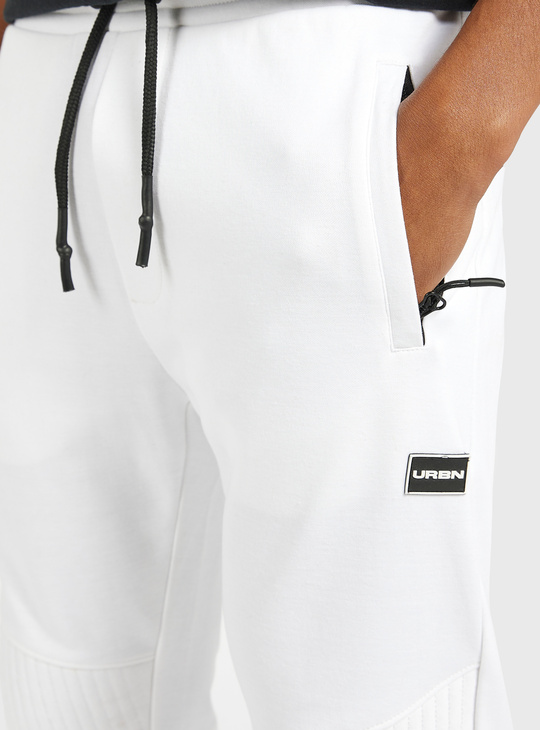 Solid Slim Fit Jog Pants with Zippered Pockets