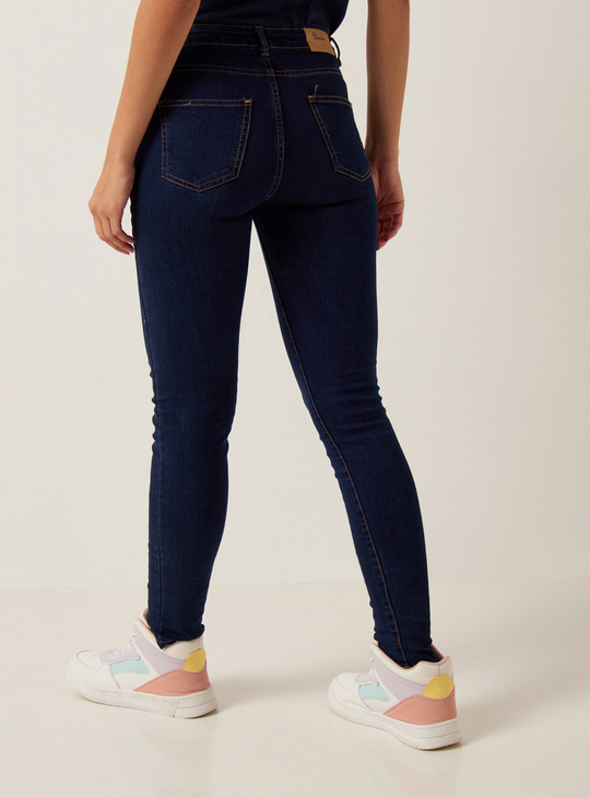 Full Length Skinny Mid-Rise Jeans with Button Closure