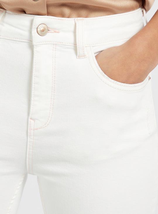 بنطلون جينز سكيني سادة بطول الكاحل وبخصر مرتفع و5 جيوب
