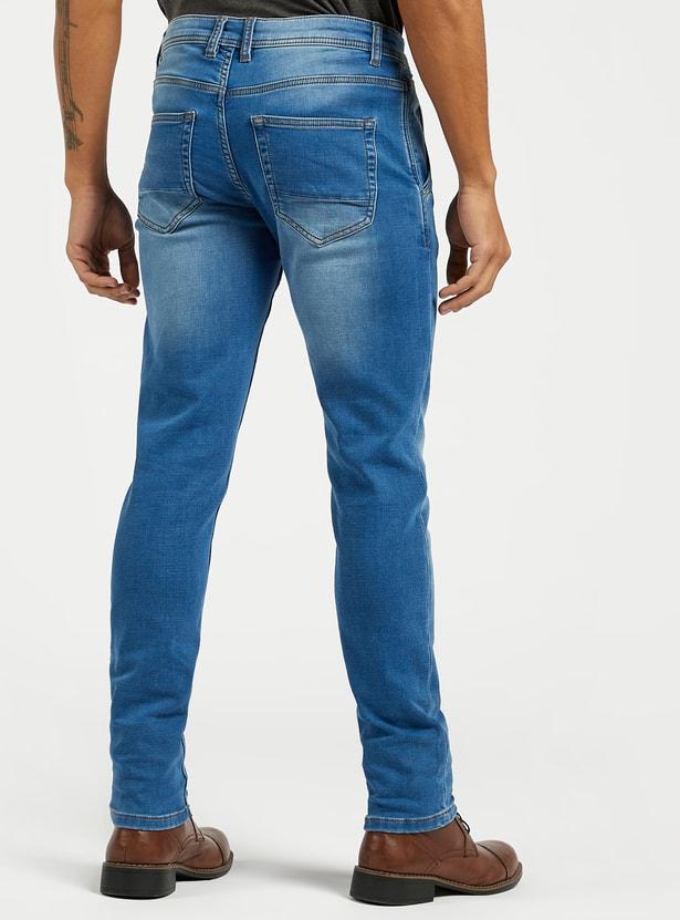 بنطلون جينز بقصة سليم وخصر متوسط الارتفاع وجيوب وزر إغلاق
