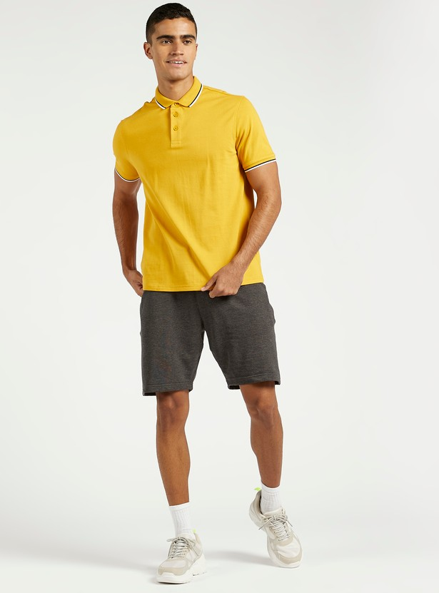 Solid Polo T-shirt with Short Sleeves and Button Closure