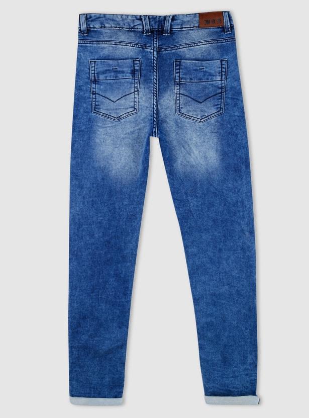بنطال جينز طويل بأزرار إغلاق