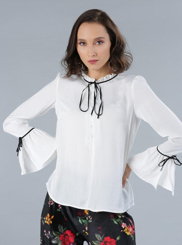 قميص بأكمام طويلة عريضة