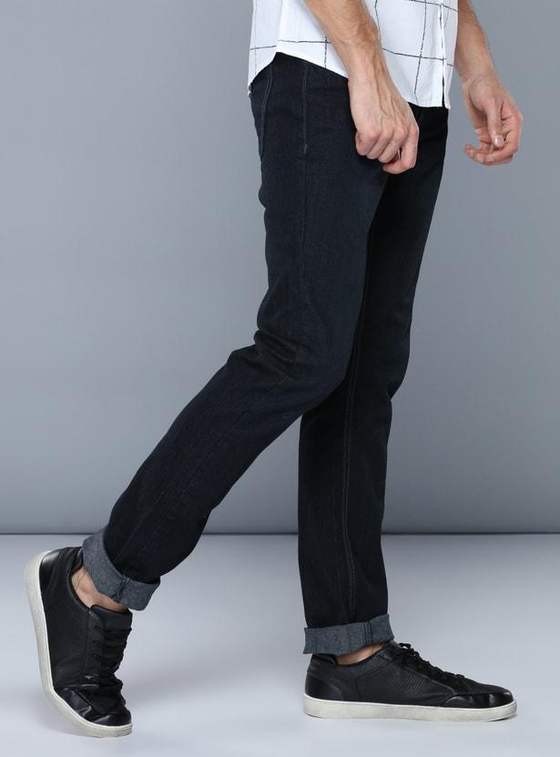 بنطال جينز طويل بأزرار وجيوب