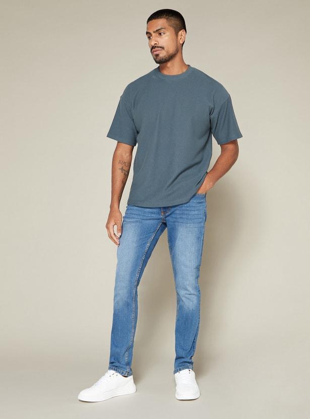 بنطال جينز طويل بأزرار وجيب