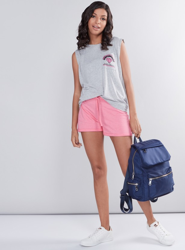 Printed Sleeveless Top with Pocket and Stud Detail