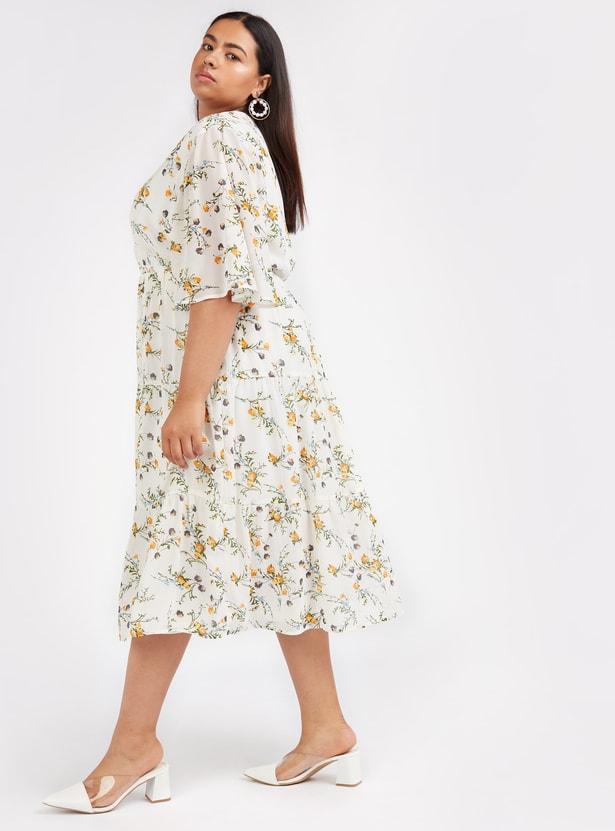 فستان إيه لاين متوسط الطول بياقة v وأكمام قصيرة وطبعات أزهار