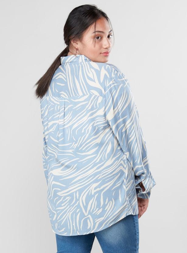قميص بطبعات حيوانات وأكمام طويلة وحوّاف منحنية