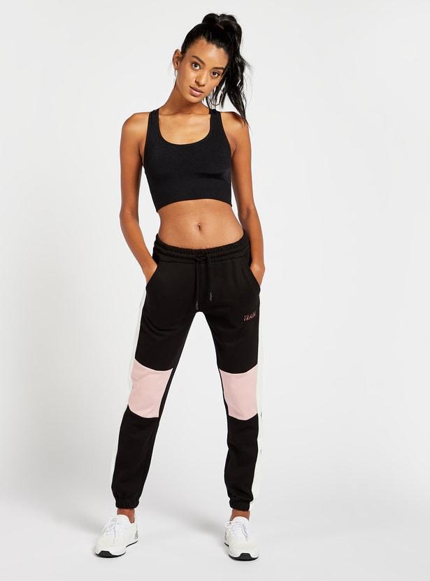 صدرية رياضية سادة سليم فيت بدعم متوسط وحمّالات متقاطعة