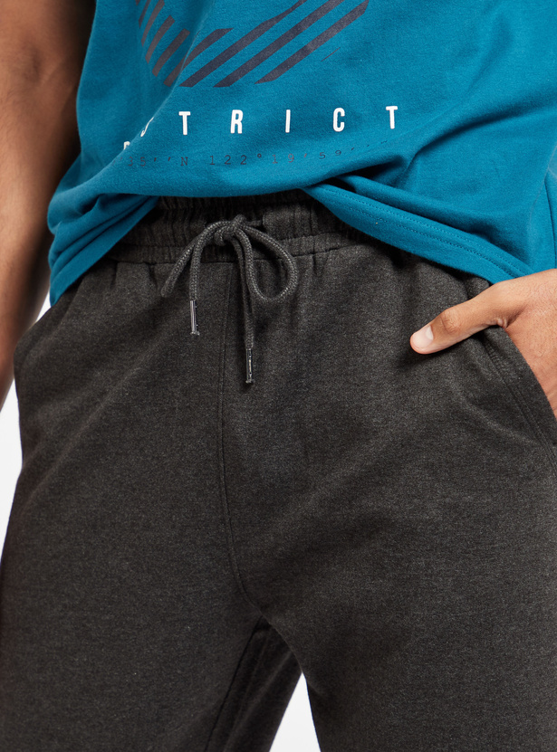 Solid Mid-Rise 3/4 Jog Pants with Pocket Detail and Drawstring Closure
