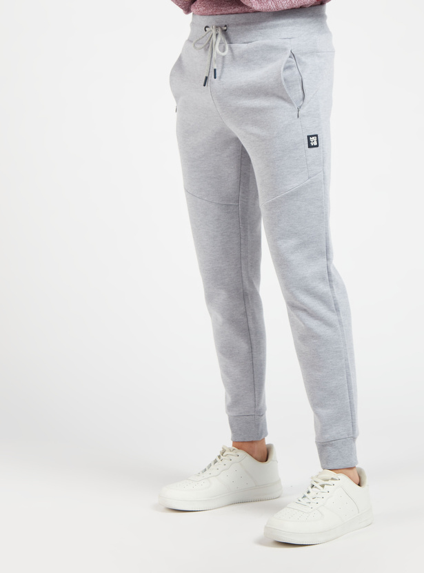 Constructed Knit Joggers with Zipper Pockets and Drawstring Closure