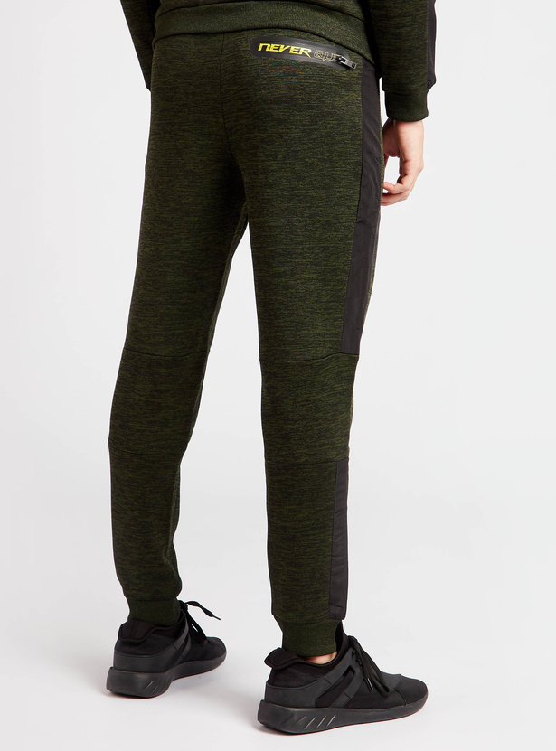 Solid Joggers with Drawstring Closure and Zipped Pockets